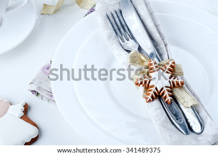 Christmas place setting with christmas cookies and candles - stock photo