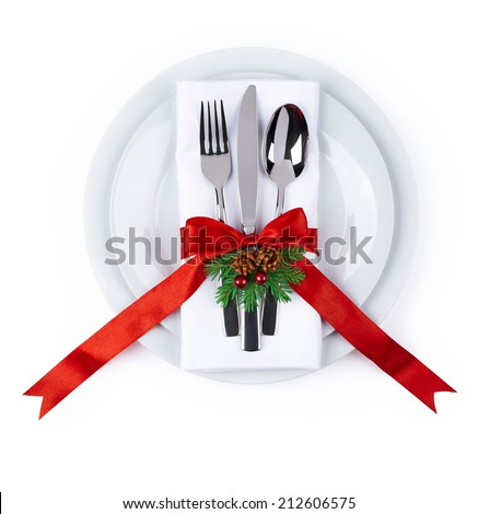 Christmas plate and silverware with red ribbon isolated on white background as design element for poster, menu, celebration