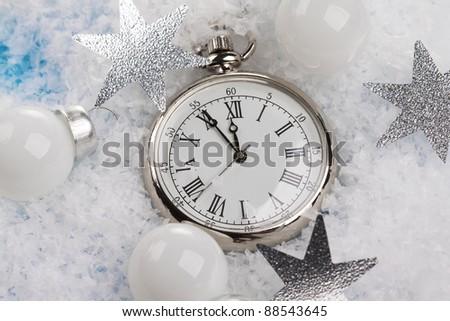 Christmas pocket watch under snow - stock photo