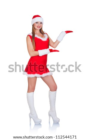 Christmas portrait of a beautiful young woman in a full-length shows something isolated on white background