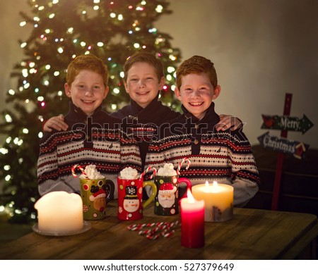 Christmas portrait of three brothers