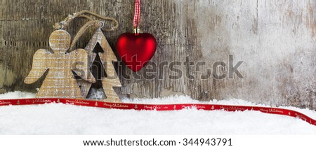 Christmas postcard with wooden background and snow - stock photo