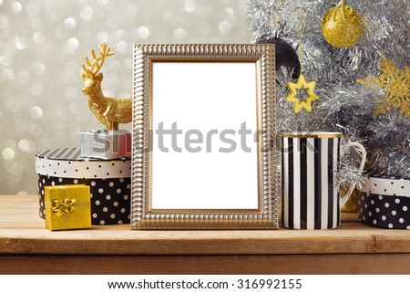 Christmas poster mock up template with Christmas tree and gift boxes. Black, golden and silver decorations - stock photo