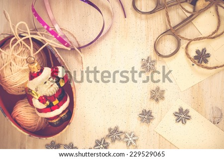 Christmas preparation handmade (scrap) Christmas  decorations on  wooden desk viewed from above with copy space and a sheet of blank paper for holiday message - stock photo