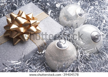Christmas present and beautiful silver christmas setting with baubles - stock photo