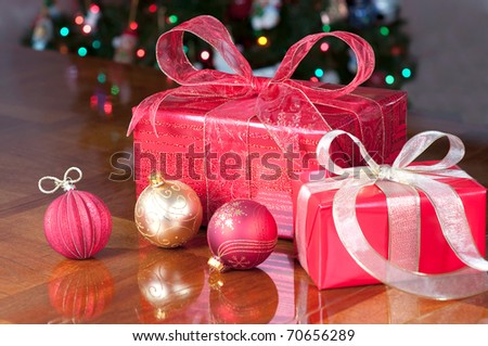 Christmas present group in red and gold with ornaments - stock photo