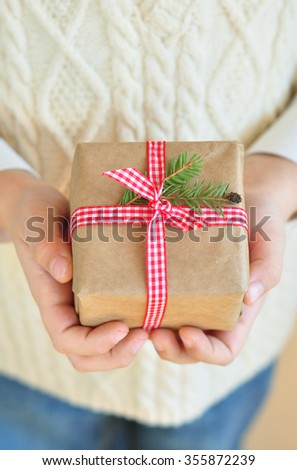 Christmas present in hands