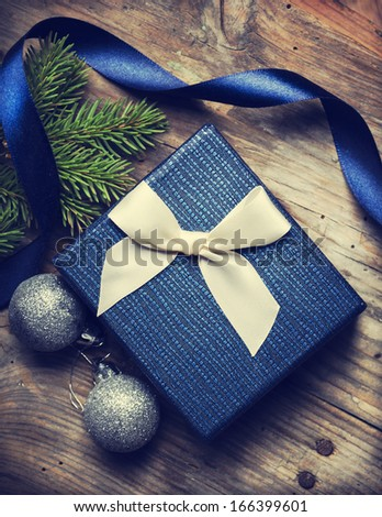 Christmas present on rustic wooden table - stock photo