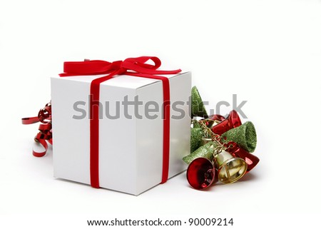 Christmas present with a red bow and bells - stock photo