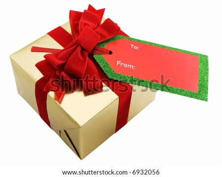 Christmas present with blank gift tag - stock photo