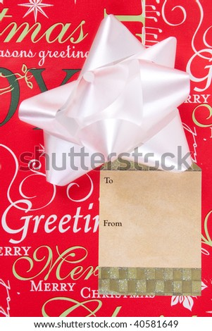 Christmas present with bow and tag - stock photo