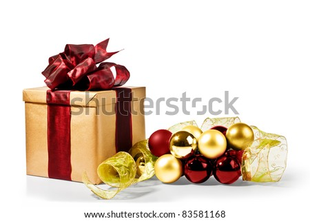 Christmas Present with decorative xmas bubbles and ribbon (gold, red and green) - stock photo