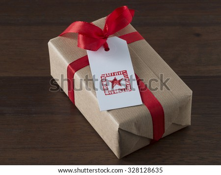 Christmas present with gift tag, printed, red ribbon