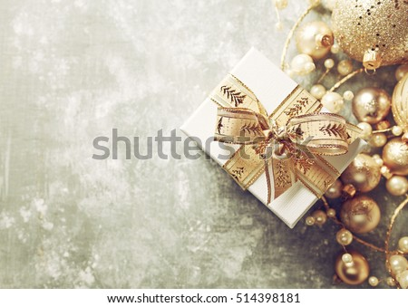 Christmas Present with Gold Ribbon and Gold Christmas Decorations