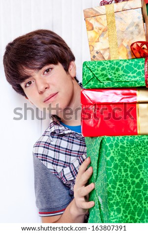 Christmas presents and a male student - stock photo