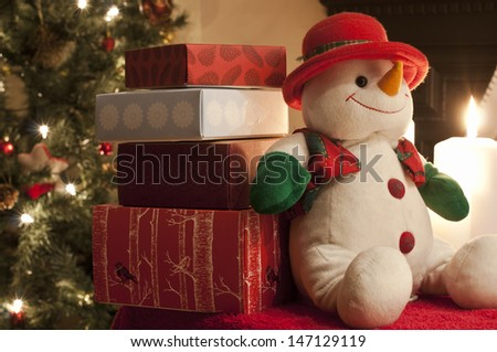 Christmas presents and snowman decoration - stock photo