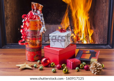 christmas presents at fireplace