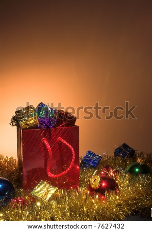 Christmas presents in a festive shopping bag. - stock photo