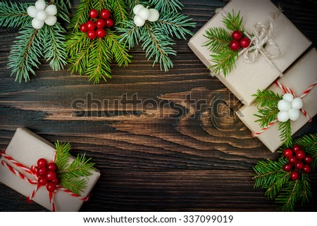 Christmas presents in boxes on a wooden background with copy space. Toned - stock photo