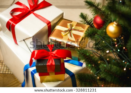 Christmas presents in colorful boxes on floor at living room - stock photo