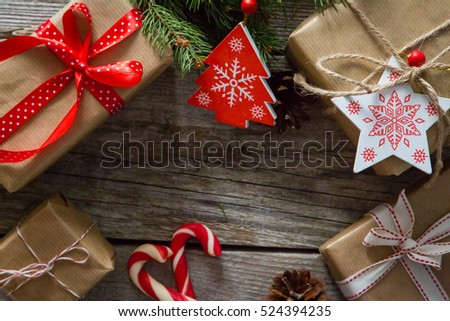 christmas presents in decorative boxes, white wood background