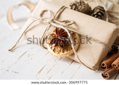 Christmas presents in rustic wrap, white wood background