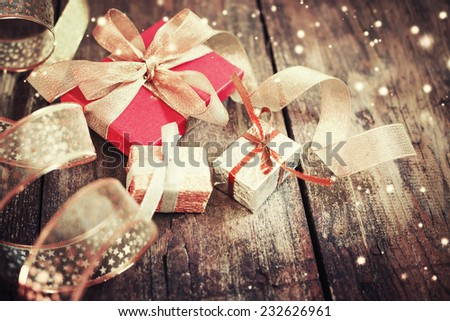 Christmas presents  on dark wooden background in vintage style / Selective focus - stock photo