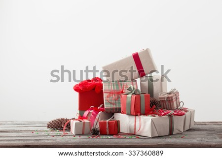 Christmas presents on old wooden table - stock photo