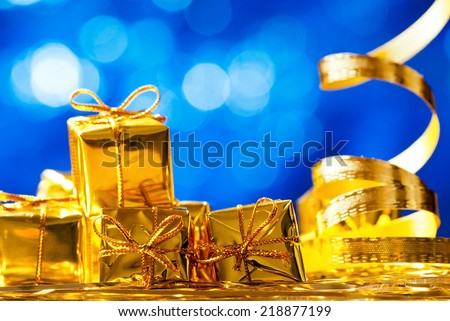 christmas presents on the blue unfocused background - stock photo