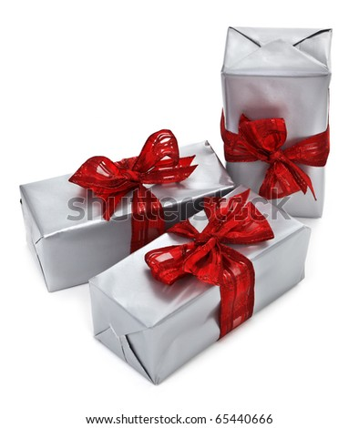 christmas presents on white background, minimal shadow among objects - stock photo