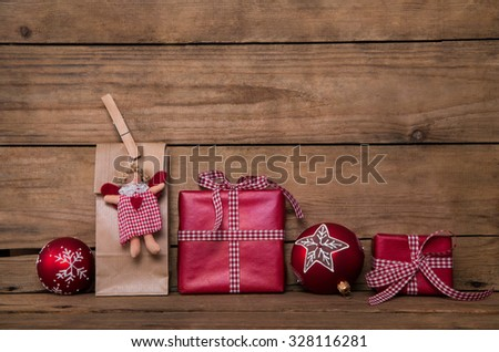 Christmas presents on wooden background with angel and red white checked gifts wrapped in paper. - stock photo