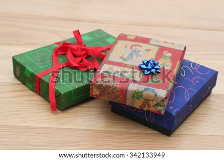 christmas presents on wooden table