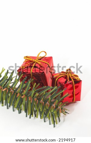 Christmas presents, ornaments on white background, . Icons of the festive season. Some space on the top for text/illustrations. Slight low depth of field to give a depth to the picture. - stock photo
