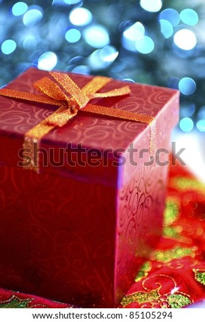 Christmas Presents. Red Christmas Present Box. Blue Lights Bokeh.