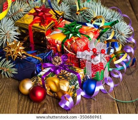 Christmas presents with christmas decorations on wooden background.