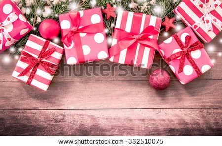 Christmas presents with decoration on wooden table in vintage color filter - stock photo