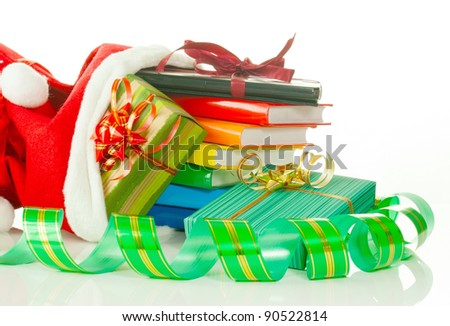 Christmas presents with e-book reader and books in bag against white background - stock photo