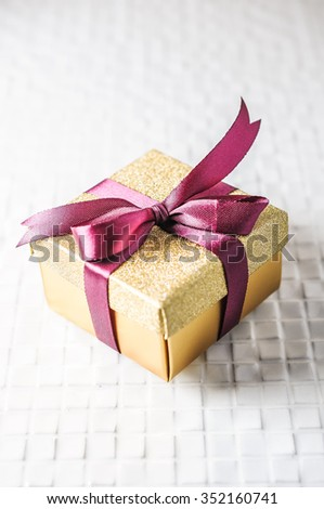 Christmas presents with purple ribbon on white background