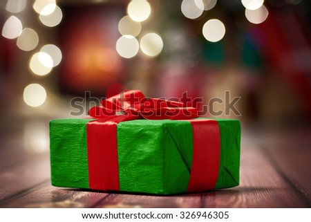 Christmas presents with red ribbon on dark wooden background - stock photo