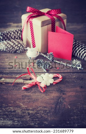 Christmas presents with red ribbon on dark wooden background in vintage style / Selective focus - stock photo