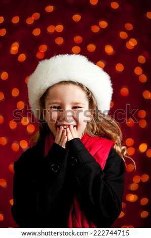Christmas: Pretty Girl Excited For Holidays With Red Light Background