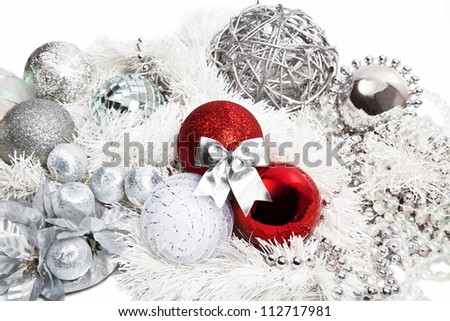 Christmas red and silver decorations on white background - stock photo
