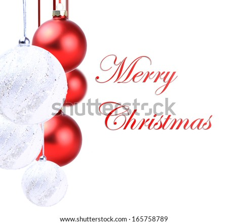 Christmas red  and white balls hanging with ribbon bows on white background - stock photo