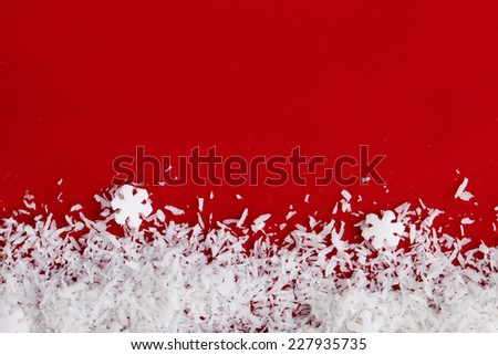 Christmas red background and snow flakes - stock photo