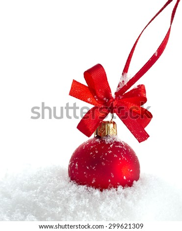 christmas red ball with ribbon bow isolated on snow white background - stock photo