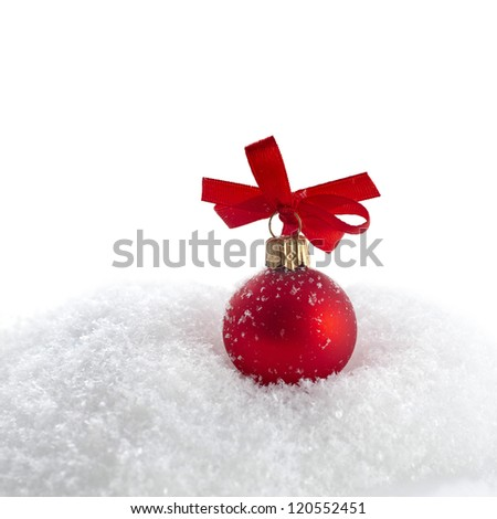 christmas red ball with ribbon bow on snow with copy space for your text on white background - stock photo