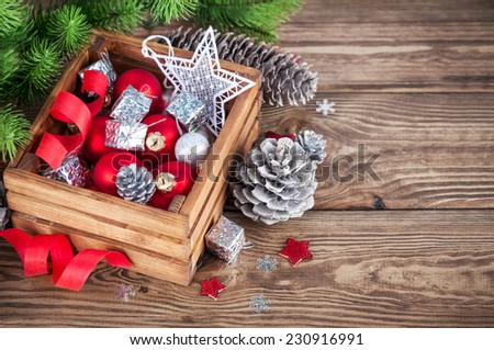 Christmas red balls and ribbons in wooden box - stock photo