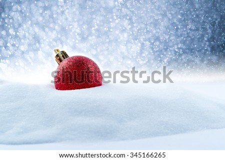 Christmas red balls decorations on snow - stock photo