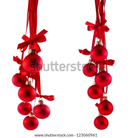 Christmas red balls hanging with ribbon bows isolated on white background - stock photo