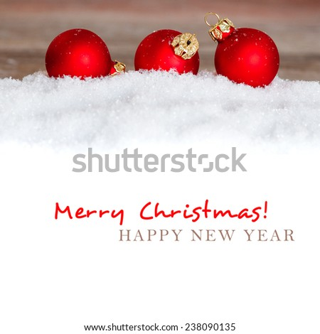 christmas red balls on snow with copy space - stock photo